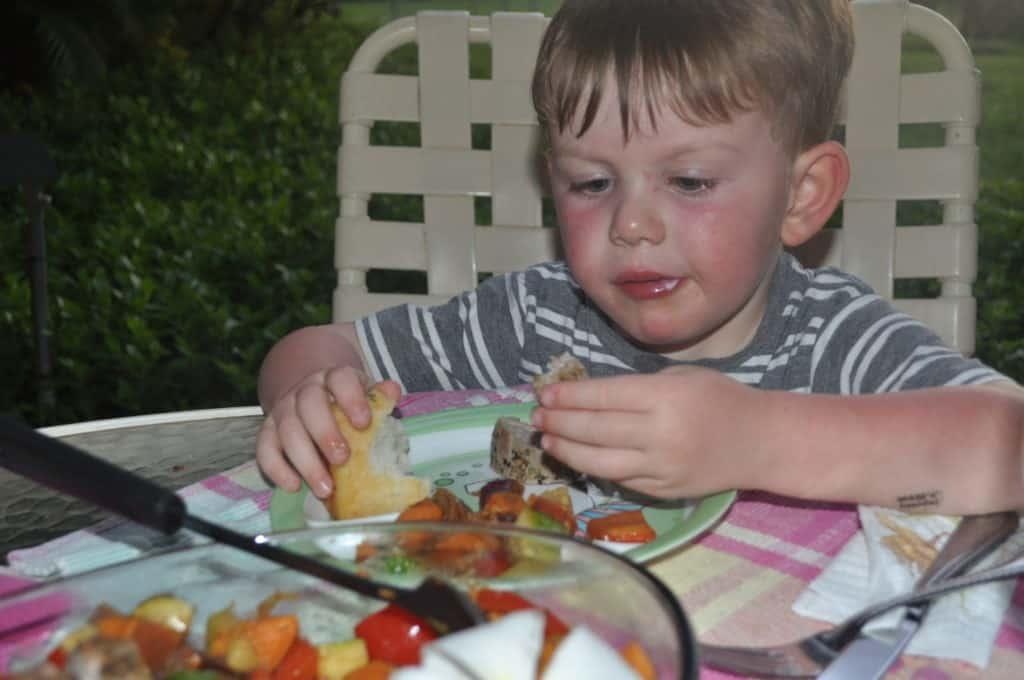 boy-eating-pork-tenderloin
