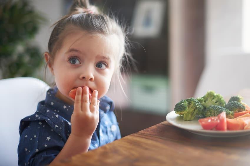 girl-eating-veggies
