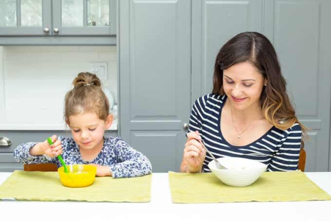 happy mother and daughter eating together