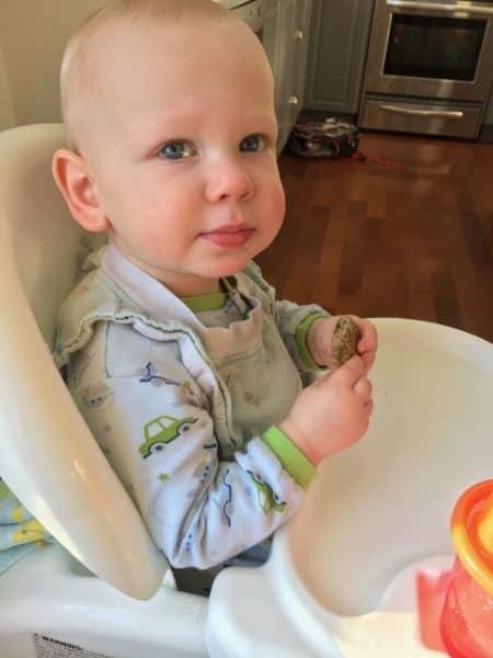 toddler enjoying vegan lentil nuggets for kids