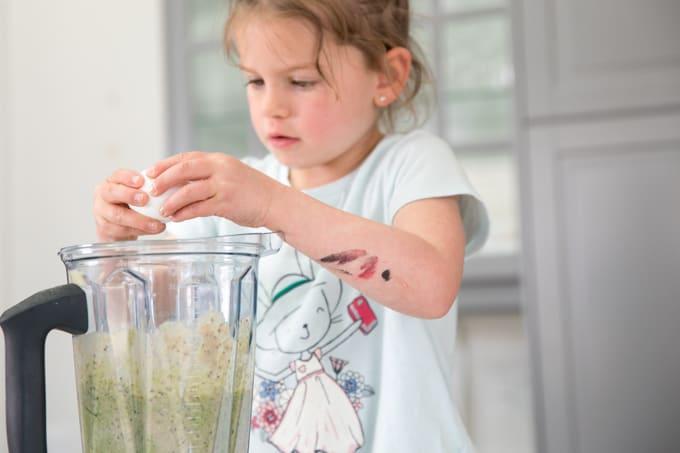 child making green monster blender muffins