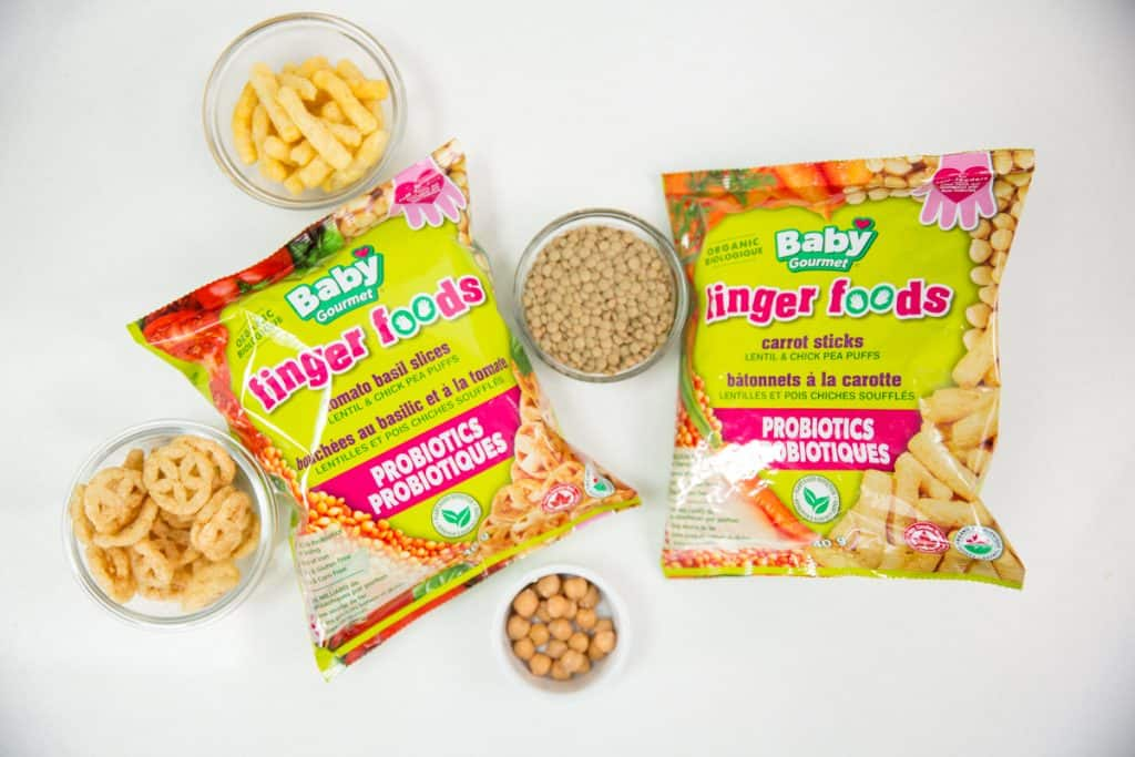 top down photo displaying Baby Gourmet products including finger foods lentil and chickpea puffs