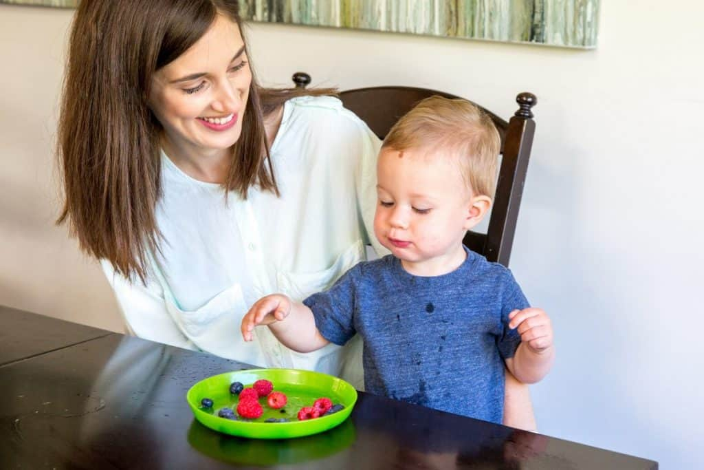 healthy child eating berries which are rich with antioxidants