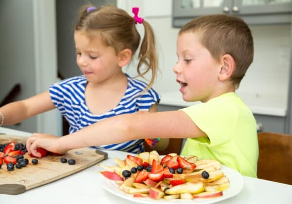 kids preparing chia fruit nachos recipe