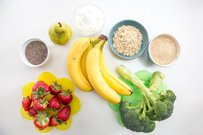 top down view of fruits and vegetables with whole grains, healthy fats and high protein dairy