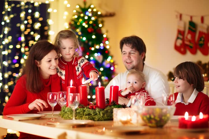 family sitting around the dinner table during holidays to help manage picky eating