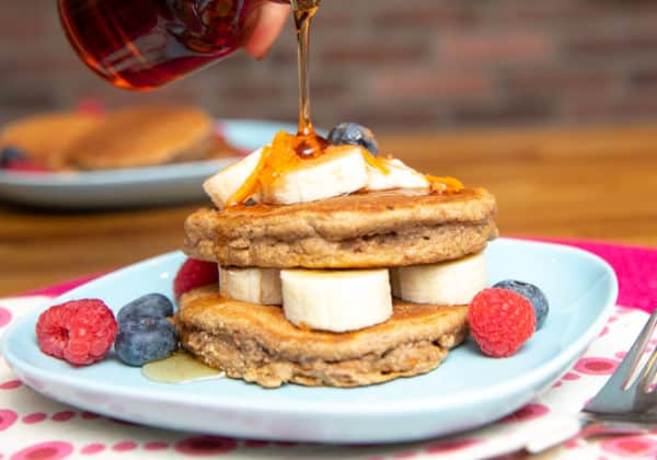 vegan carrot cake pancakes stack with berries and fruit
