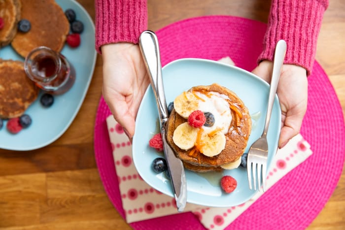 carrot cake pancakes with berries and syrup