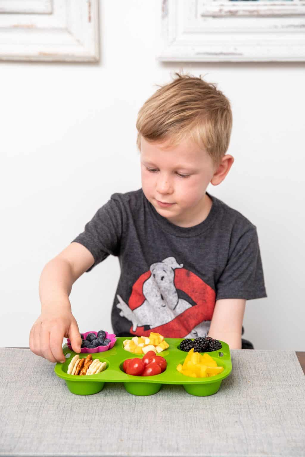 child eating from a snack board