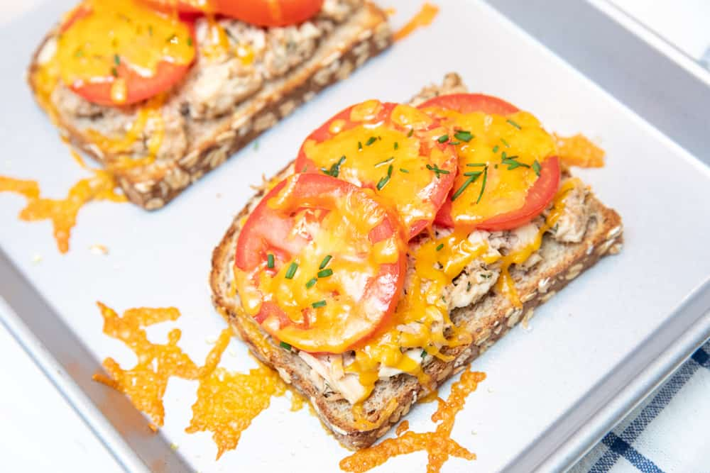 tuna melts on top of whole grain bread with cheese and tomatoes