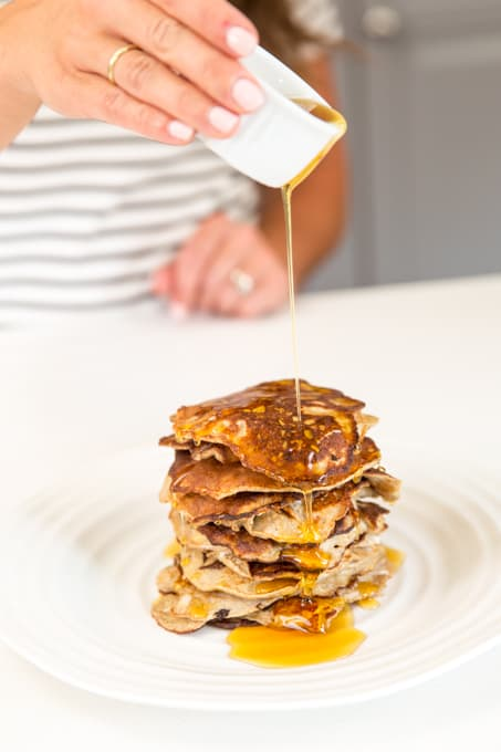 syrup pouring over stack of flourless banana pancakes