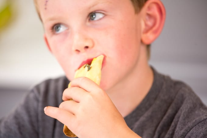 child eating taquitos